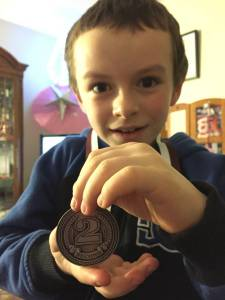 Aiden's 2nd place medal for hockey 2016